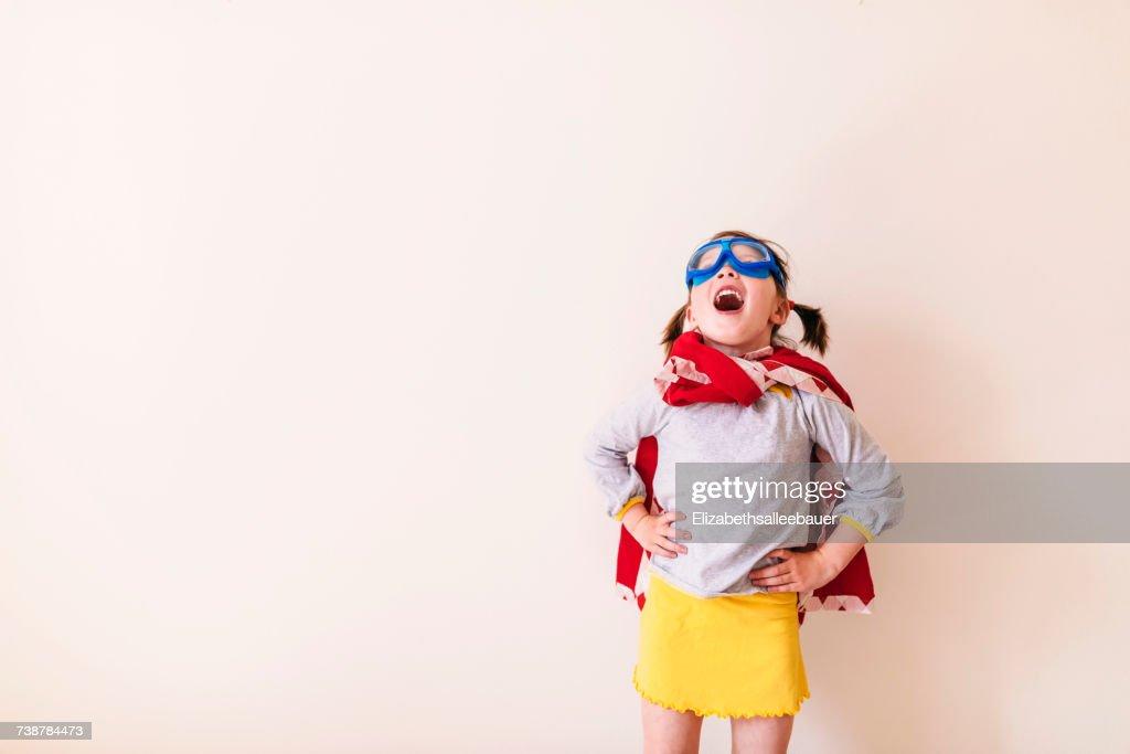 Girl dressed as a superhero : Stock Photo