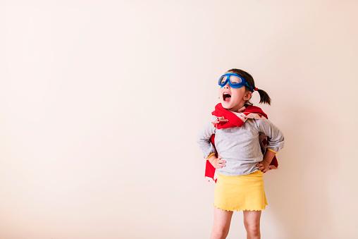 Girl dressed as a superhero - gettyimageskorea