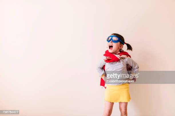 girl dressed as a superhero - images foto e immagini stock