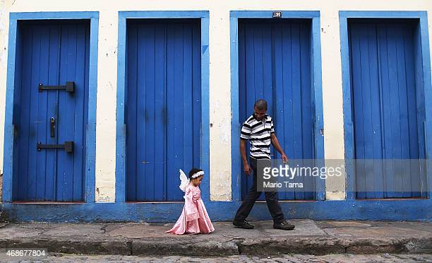 A girl dressed as an angel walks home after marching in the annual Easter procession during traditional Semana Santa festivities on April 5 2015 in...
