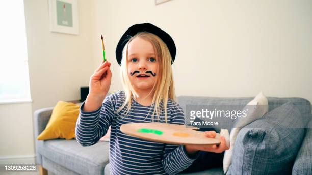 girl dressed as artist painting - headwear stock pictures, royalty-free photos & images