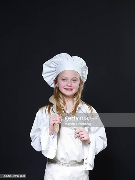 Girl (6-8) dressed as chef