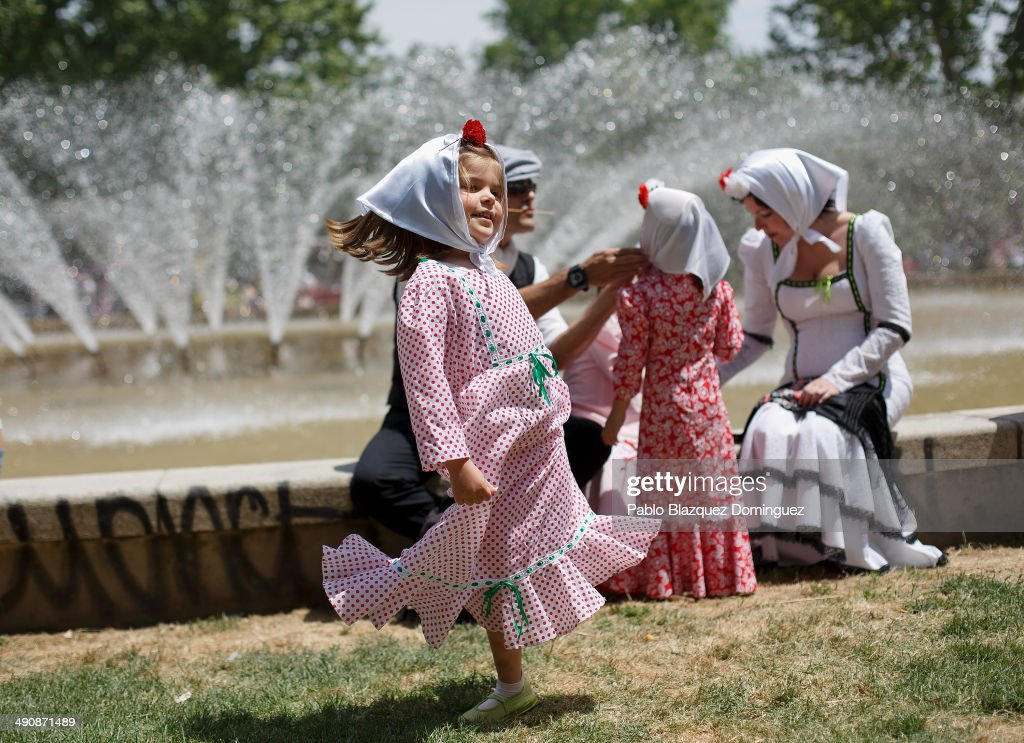 A girl dressed as 'chulapa' dance during the San Isidro festivities at Pradera de San Isidro park on May 15, 2014 in Madrid, Spain. During the festivities in honor of San Isidro Labrador in Madrid revelers take the streets and enjoy music and popular food. Chulapos or Goyescos dance the regional dance known as 'chotis' wearing traditional costumes of Madrid.