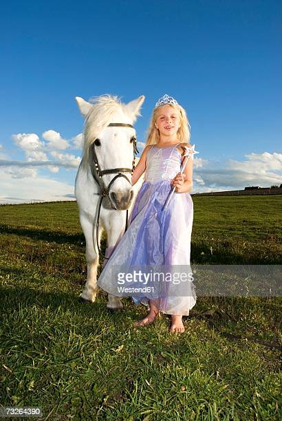 Girl (7-9) dressed as fairy by pony