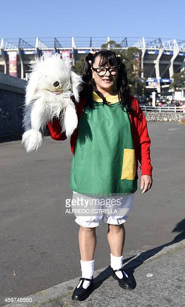 A girl dressed as 'La Chilindrina' a character of the sitcom 'El Chavo del Ocho' poses outside the 105000capacity Azteca stadium in Mexico City on...