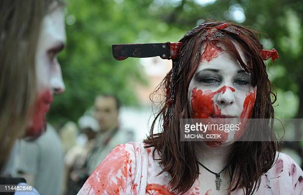 A girl dressed as zombie participates in a zombie walk in Prague on May 21 2011 This is the fourth time the event has been held PHOTO AFP/MICHAL CIZEK