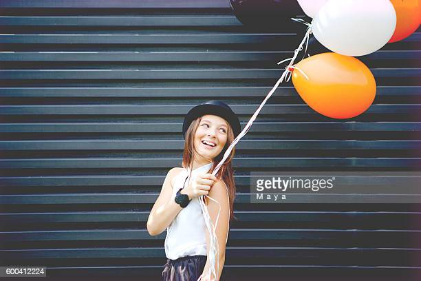Girl dressed for Halloween with balloon