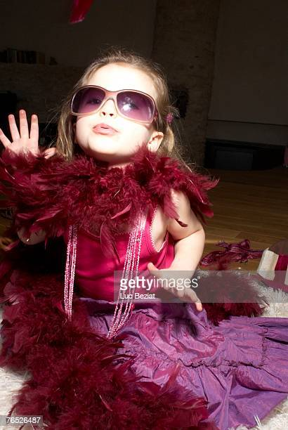 Girl (2-4) dressed for party, acting like a diva.