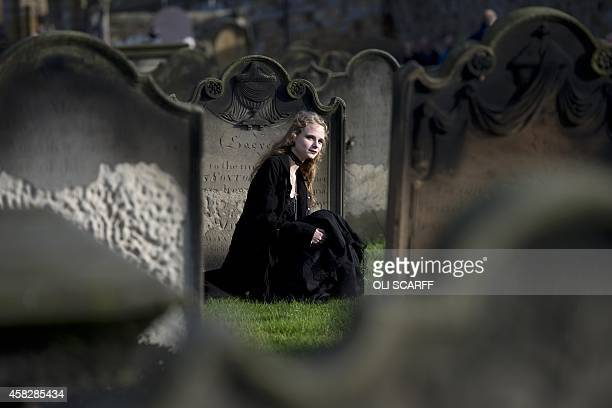 A girl dressed in a gothic costume is pictured during the biannual 'Whitby Goth Weekend' festival in Whitby Northern England on November 2 2014 The...