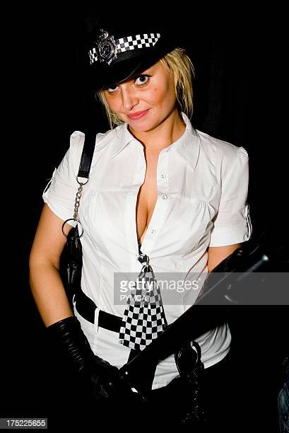 Girl dressed in a police costume with trunction posing for a photograph in a nighclub Club Class Maidstone Kent