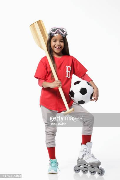 girl dressed in baseball uniform holding sports equipment - football strip stock pictures, royalty-free photos & images