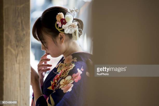 Girl dressed in colorful kimono during their Coming of Age Day celebration ceremony at Tokyo, January 08 Japan. The Coming of Age Day is a holiday to...