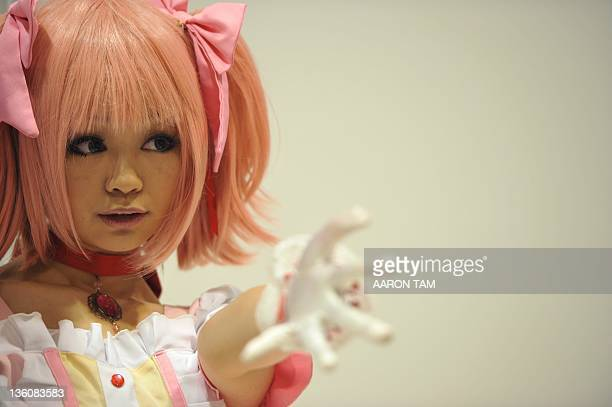 A girl dressed in cosplay poses for photos at the 10th Asia Game Show 2011 in Hong Kong on December 23 2011 Video game lovers started lining up for...