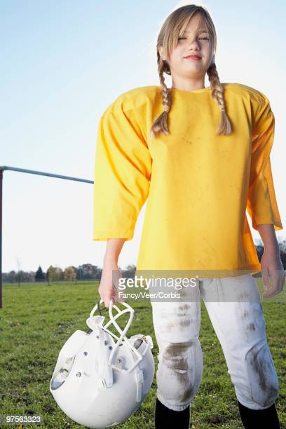 girl dressed in football uniform - sports uniform stock pictures, royalty-free photos & images