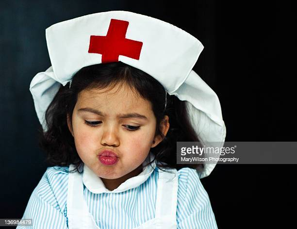 girl dressed in nurse costume - naughty nurse images stock photos and pictures
