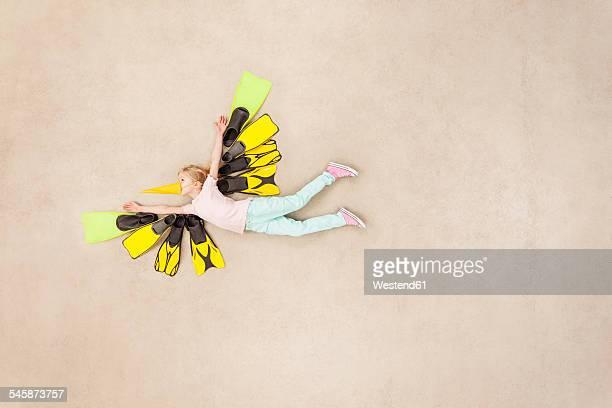 Girl dressed up as flying bird