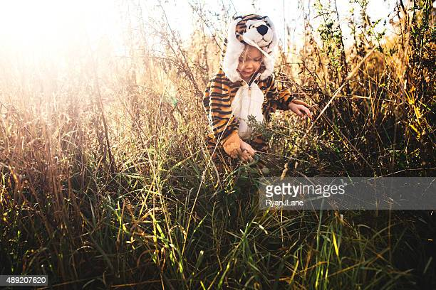 Girl Dressed Up as Lion in Tall Grass