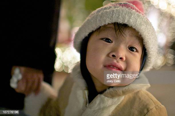 girl dressed warmly enjoying the holidays lights - young thick girls stock photos and pictures