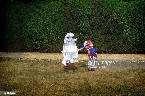 Girl dresses up as Catherine Middleton and poses in a garden on the day of the Royal Wedding between Prince William and Catherine Middleton, on April...