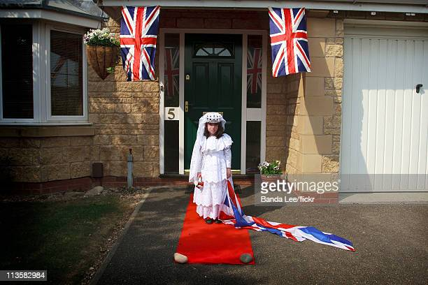 A girl dresses up as Catherine Middleton and poses in front of her home on the day of the Royal Wedding between Prince William and Catherine...