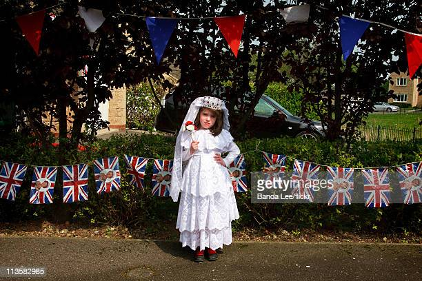 Girl dresses up as Catherine Middleton and poses in front of her home on the day of the Royal Wedding between Prince William and Catherine Middleton,...