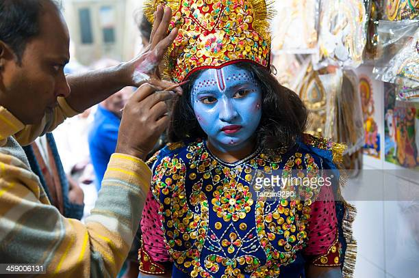 girl dressing and making up as krishna in old dhaka - lord krishna stock photos and pictures
