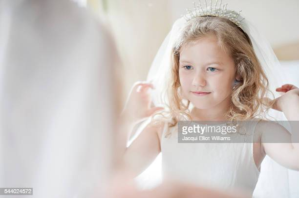 a girl dressing up as a bride. - girl in mirror stock photos and pictures