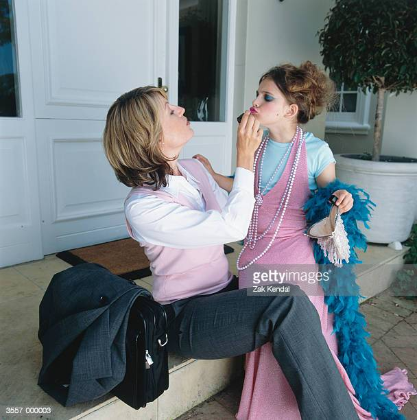 Girl Dressing Up with Mother