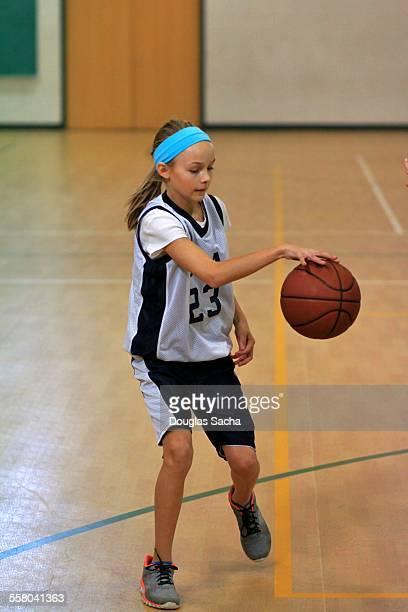 Girl dribbling a basketball