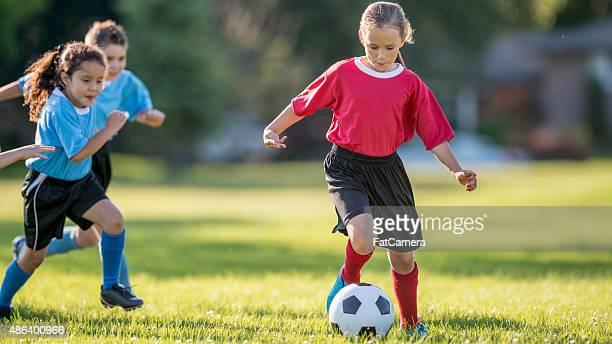 Girl Dribbling a Soccer Ball