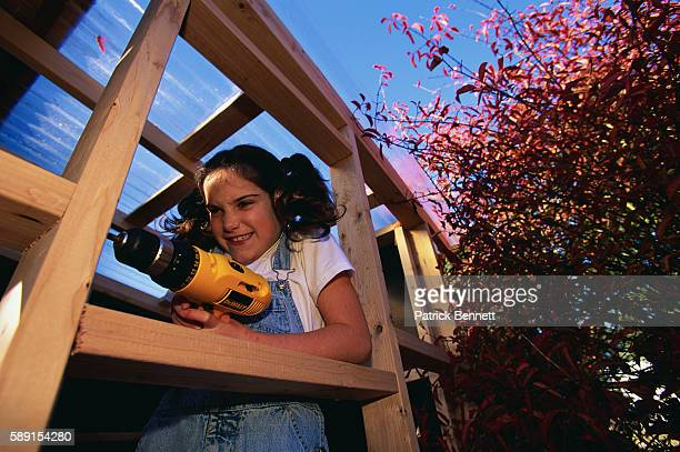 Girl Drilling Tree House