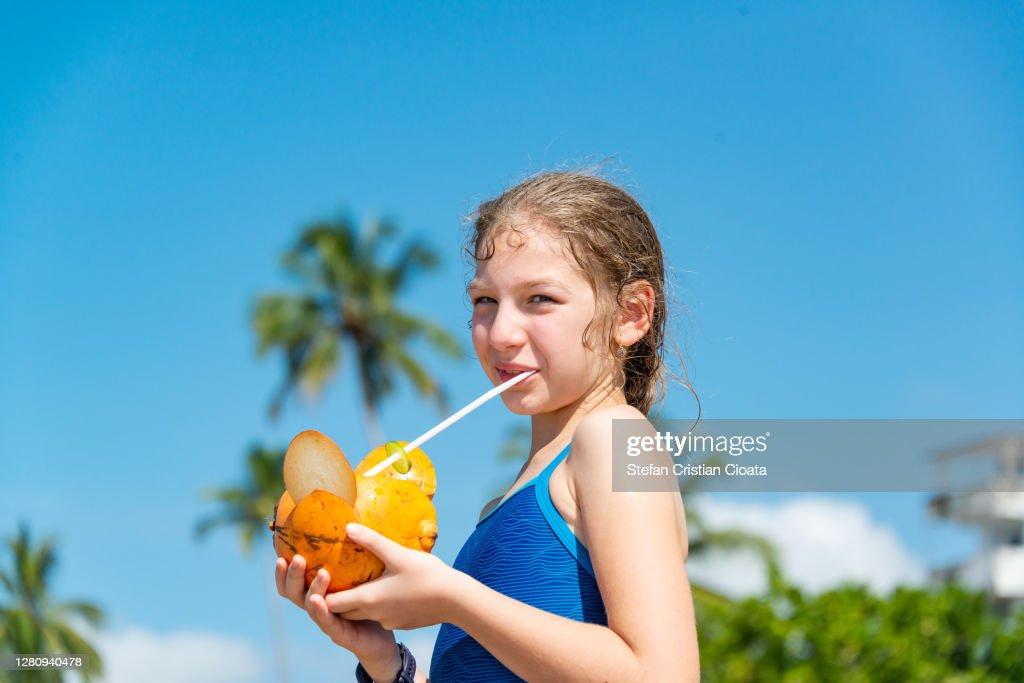 Girl Drinking Coconut Milk At Mirissa Beach Matara Sri