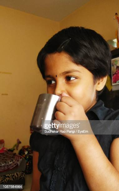 Girl Drinking Coffee At Home