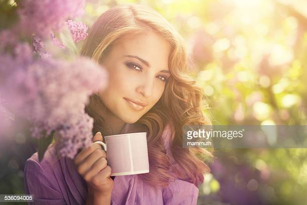 girl drinking coffee in the garden