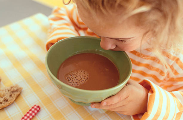 Girl drinking from bowl