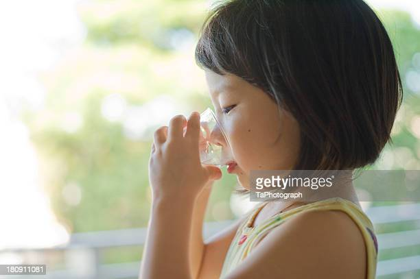 girl drinking glass of water - nur japaner stock-fotos und bilder