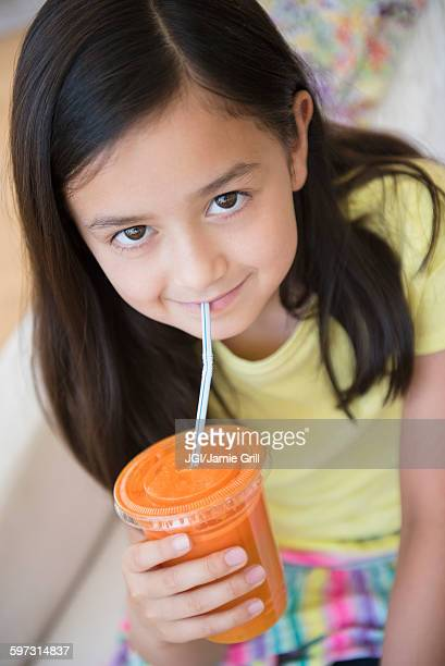 Girl drinking healthy carrot juice