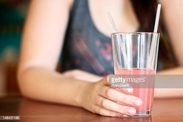 Girl drinking pink lemonade