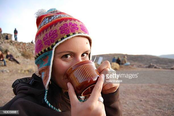 Girl drinking tea in Amantani, Titicaca Lake