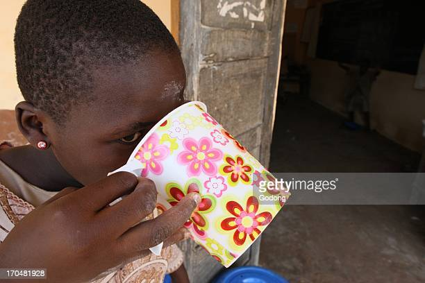 Girl drinking water Lome Togo