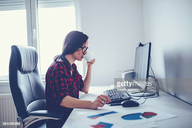 Girl drinks coffee at the office