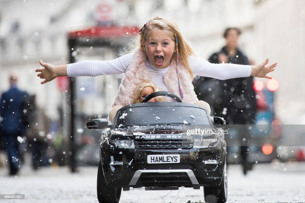 A girl drives a Range Rover Evoque Ride-on electric car on Regents Street as Hamley's announce it's top ten toys for Christmas at Hamleys on October 12, 2017 in London, England.