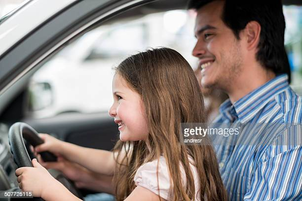 girl driving a car - test drive stock pictures, royalty-free photos & images