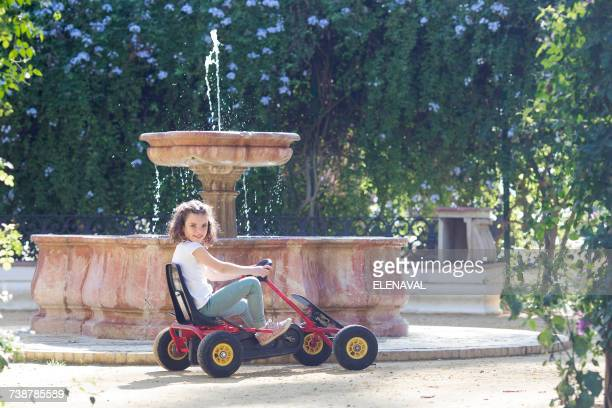 Girl driving in a go cart