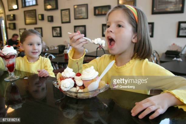 A girl eating a banana split in The Palace Ice Cream and Sandwich Shop