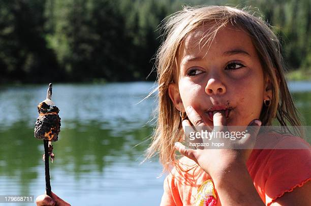 Girl eating a marshmallow
