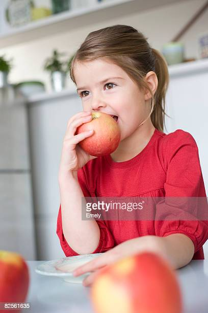 girl eating an apple - kid girl eating apple stock photos and pictures