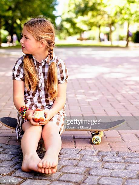Girl eating an apple Sweden.