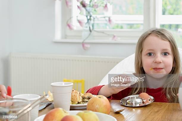 Girl eating an egg