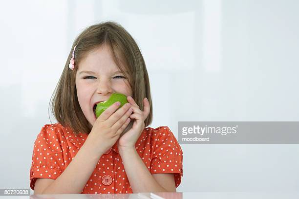 girl eating apple - kid girl eating apple stock photos and pictures